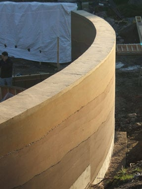curved-wall-rammed-earth-layers
