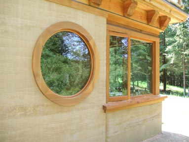 rammed-earth-round-window