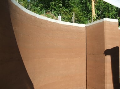 curved-rammed-earth-wall